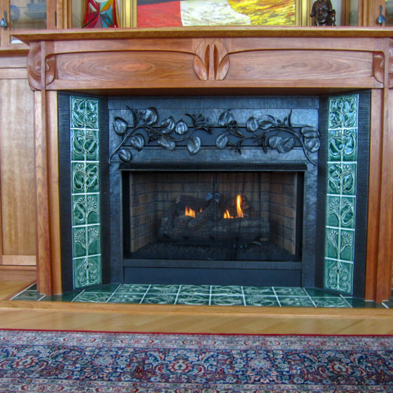 Fireplace surround with hand-carved details