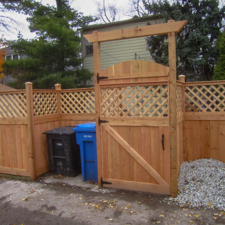 Alley view of fence with security gate