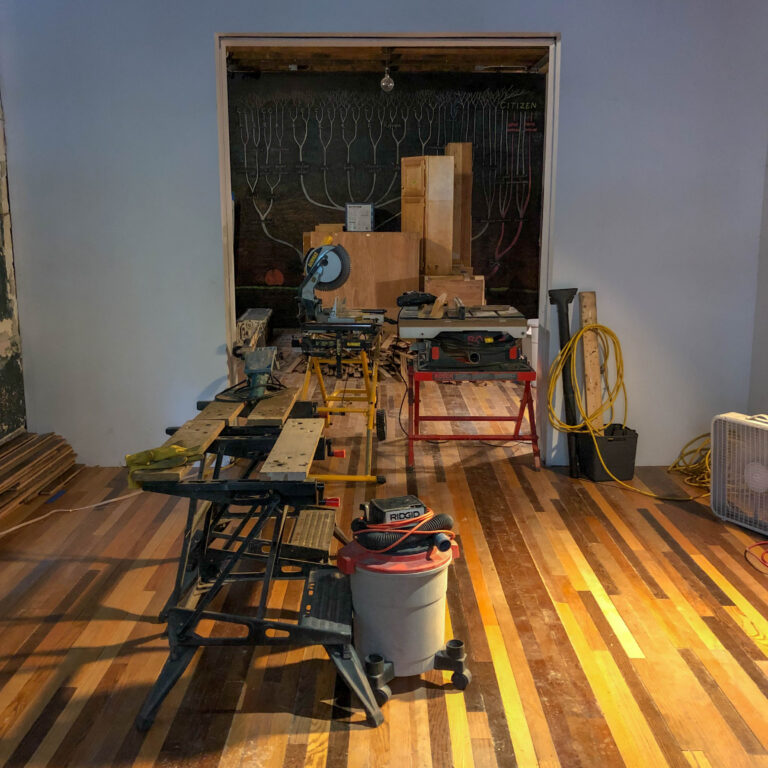 Floorboards from Goat Island Retrospective installed into 6018North arts space