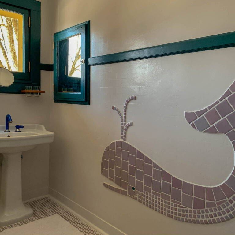 Our tile work had to compliment this fun, original mosaic