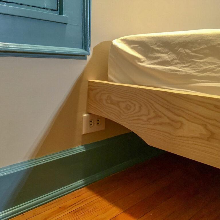 Bedframe detail around outlet