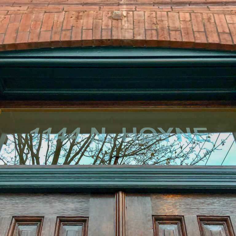 New sandblasted address transom glass in restored window