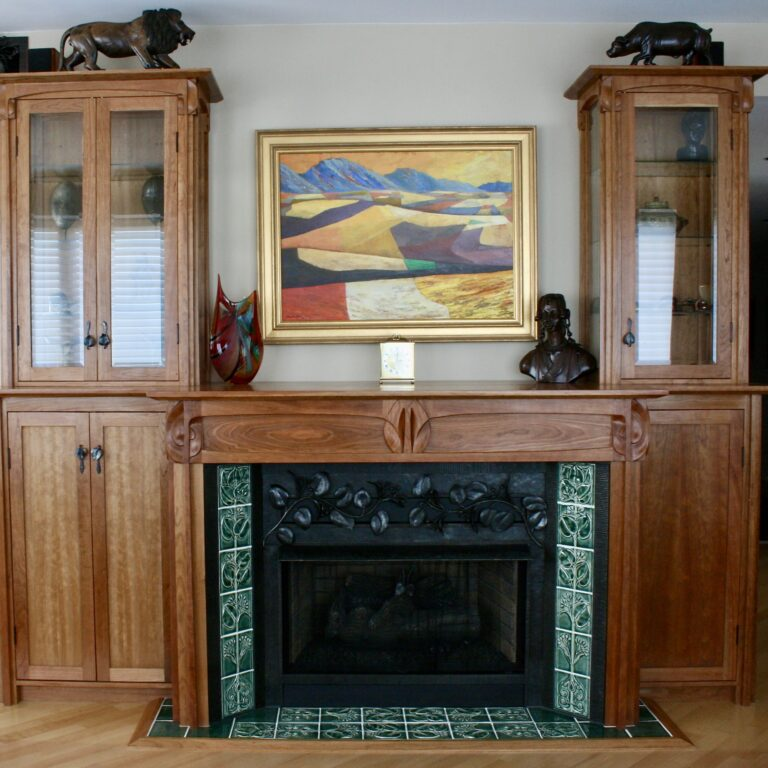Cherry wood, wrought iron, and tile fireplace