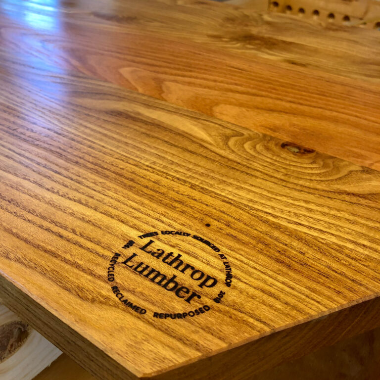 Custom brand for wood milled on Lathrop Homes property