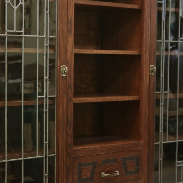 Designed to compliment restored leaded glass door panels. Detail of retrofitted new hardware and color matched finish.